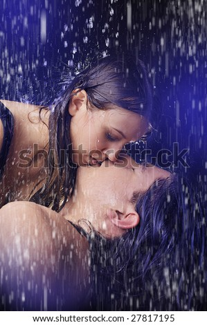 Kissing In The Rain - stock photo