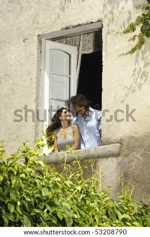kissing in the window - stock photo