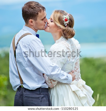 Kissing Suite in nature close-up portrait - stock photo