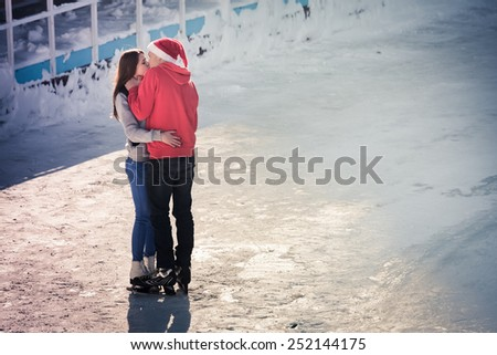 kissing teen couple at ice rink at Medeo, Almaty