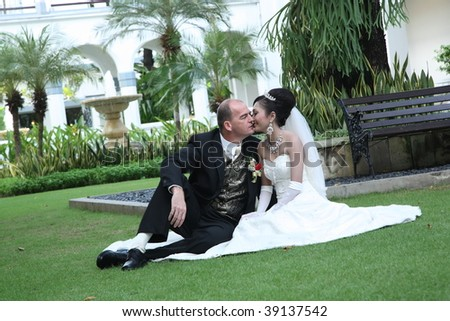 Kissing the Bride - stock photo