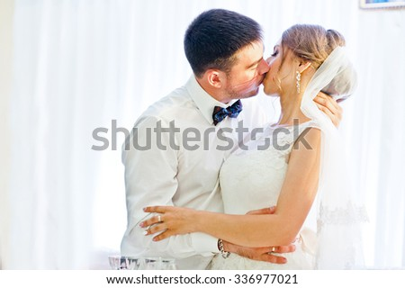 kissing wedding couple at the restaurant - stock photo