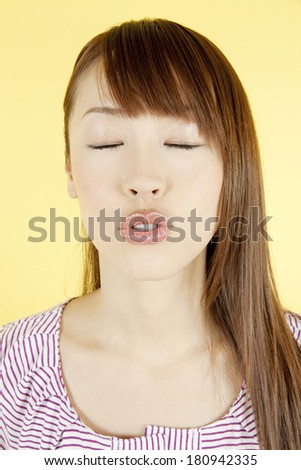 Kissing woman's face