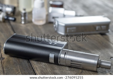 Kit for healthy smoking on wooden background,  e-cigarette - stock photo
