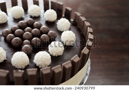 Kit Kat Chocolate cake on cakestand on tp of wooden table - stock photo