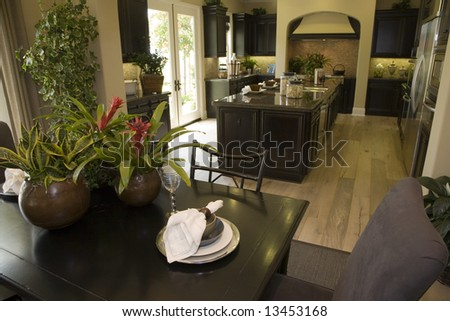 Kitchen and breakfast table with modern tableware. - stock photo