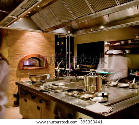 kitchen and busy chefs of hotel - stock photo