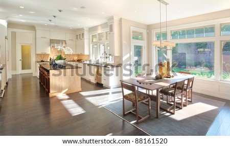 Kitchen and Dining Room Panorama in New Luxury Home - stock photo