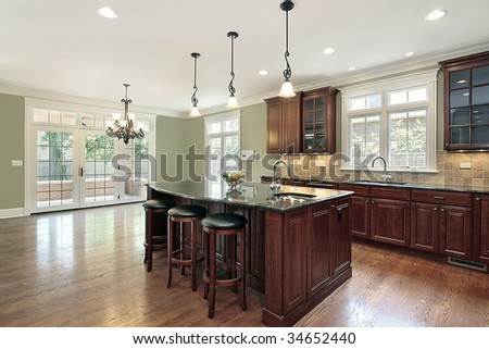 Kitchen and eating area in new construction home - stock photo