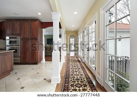 Kitchen and hallway with views outside - stock photo