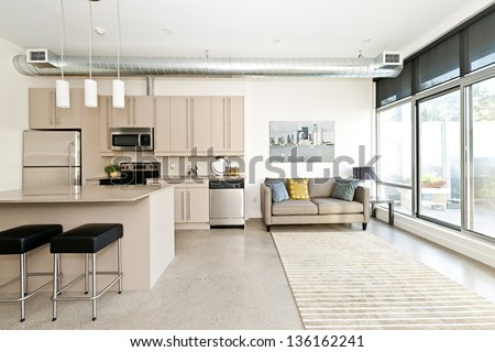 Kitchen and living room of loft apartment - stock photo