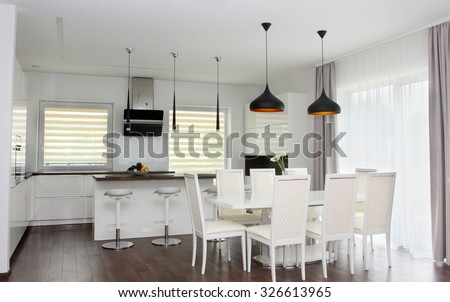 Kitchen and living room. White interior