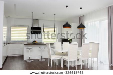 Kitchen and living room. White interior - stock photo
