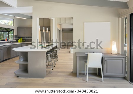 Kitchen and working desk with copy space for art work in luxury home  - stock photo