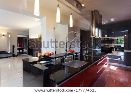 Kitchen appliance, counter, sink and cooker - stock photo