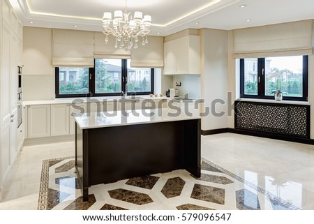 Kitchen Bar Of The Center Room And Crystal Chandelier Over Big Windows With Beige