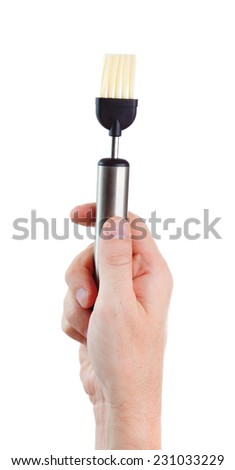 kitchen brush in hand on a white background - stock photo