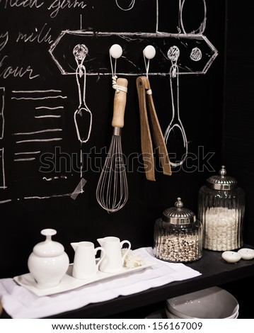 Kitchen cooking utensil on steel rack