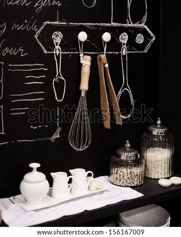 Kitchen cooking utensil on steel rack - stock photo