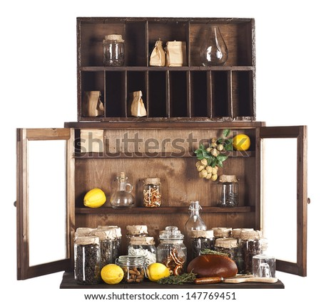 kitchen cupboard with doors open, full of cans and products - stock photo