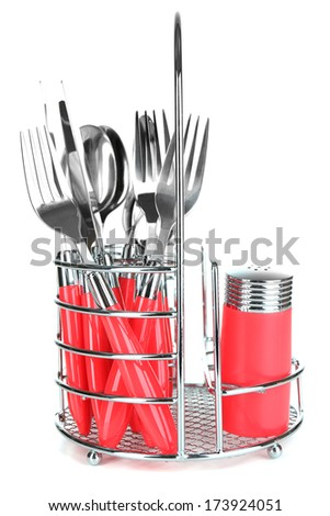 Kitchen cutlery in metal stand isolated on white - stock photo
