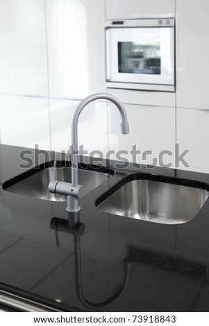 kitchen faucet and oven modern black and white interior design - stock photo