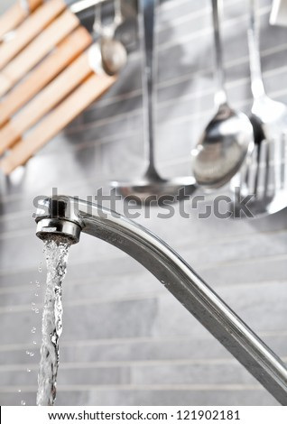 Kitchen faucet with dropping water and kitchen tools