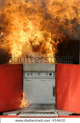 Kitchen fire as a result of trying to put out an oil or fat or chip pan fire with water - stock photo