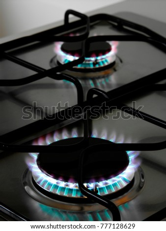 kitchen gas cooker with burning fire propane gas