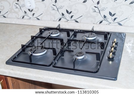 Kitchen gas stove with four burners - stock photo