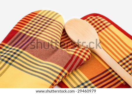 Kitchen glove and potholder with wooden spoon on white background