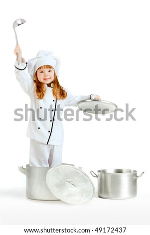 Kitchen hand. A little pretty girl dressed as a kitchen hand in a cooking pot holding a top and a ladle. - stock photo