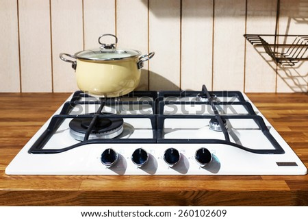 kitchen hob with pans - stock photo