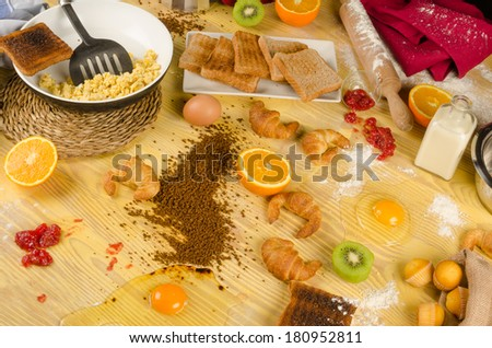 Kitchen in a very messy state after kids prepared  fathers day breakfast - stock photo