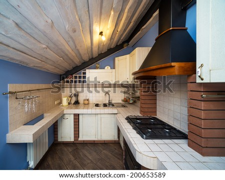 Kitchen in country style . Penthouse. - stock photo
