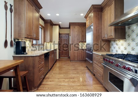 Kitchen in home with oak wood cabinetry - stock photo