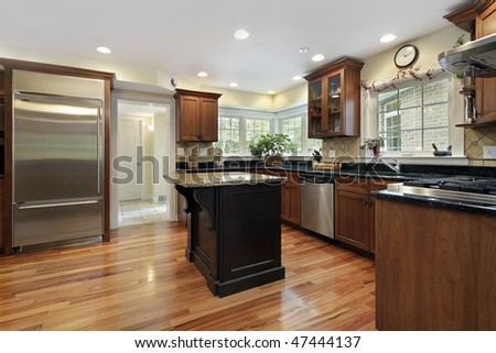 Kitchen in luxury home with black and granite island