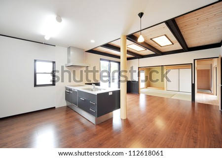 Kitchen in luxury home with dark wood cabinetry -1-1 - stock photo