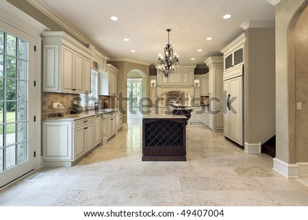 Kitchen in luxury home with double deck island - stock photo