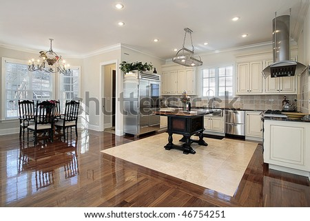 Kitchen in luxury home with eating area - stock photo