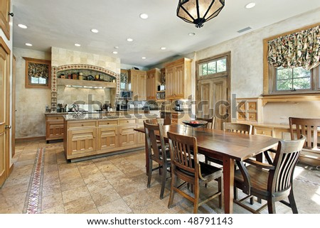 Kitchen in luxury home with eating area