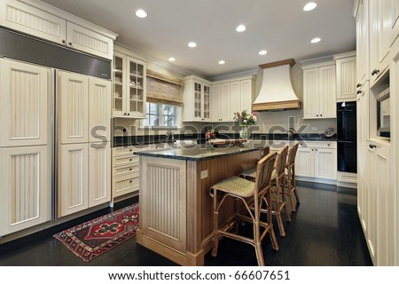 Kitchen in luxury home with granite and wood island - stock photo