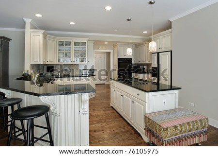 Kitchen in luxury home with granite island - stock photo
