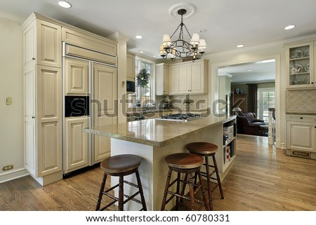 Kitchen in luxury home with large center island - stock photo
