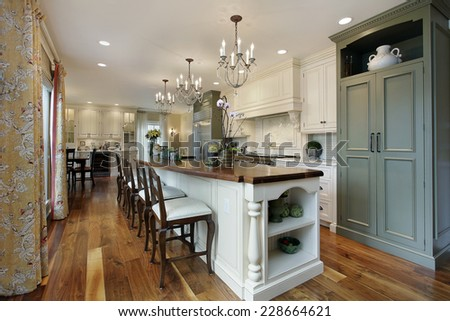 Kitchen in luxury home with large island - stock photo
