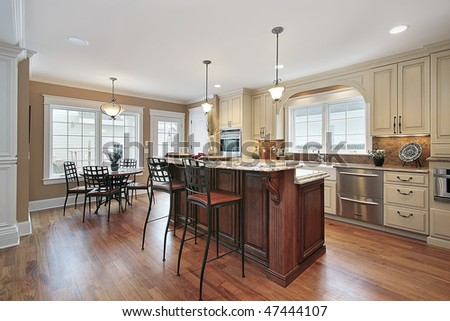 Kitchen in luxury home with two tiered island