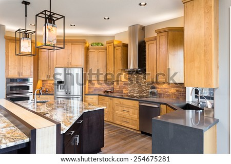 Kitchen in Luxury Home with View of Cabinetry - stock photo