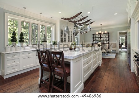 Kitchen in luxury home with white granite island - stock photo