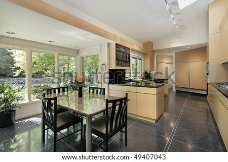 Kitchen in luxury home with windowed eating area - stock photo