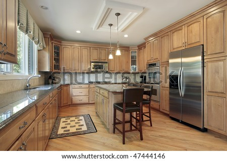 Kitchen in luxury home with wood cabinetry